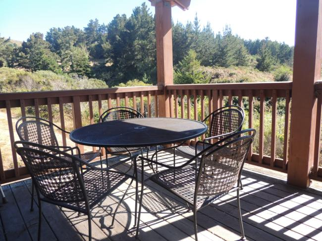 Small table & chairs on covered back deck